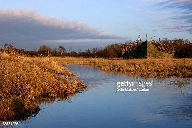 scenic view of river against sky - oresund region stock photos and pictures
