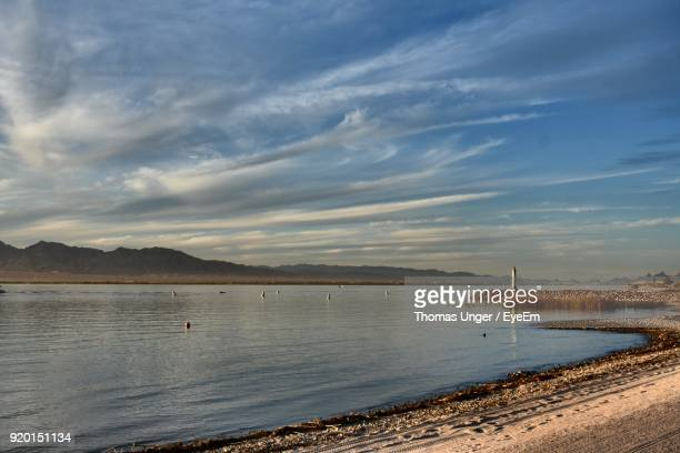 scenic view of river against sky - lake havasu stock photos and pictures