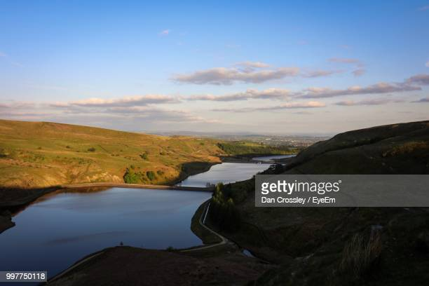 Scenic View Of River Amidst Landscape Against Sky