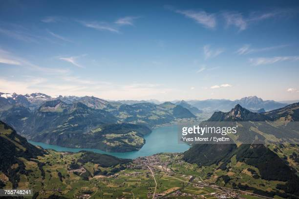 scenic view of river amidst mountain against sky - schwyz stock pictures, royalty-free photos & images