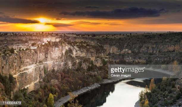 scenic view of river amidst mountains against sky during sunset - segovia stock pictures, royalty-free photos & images