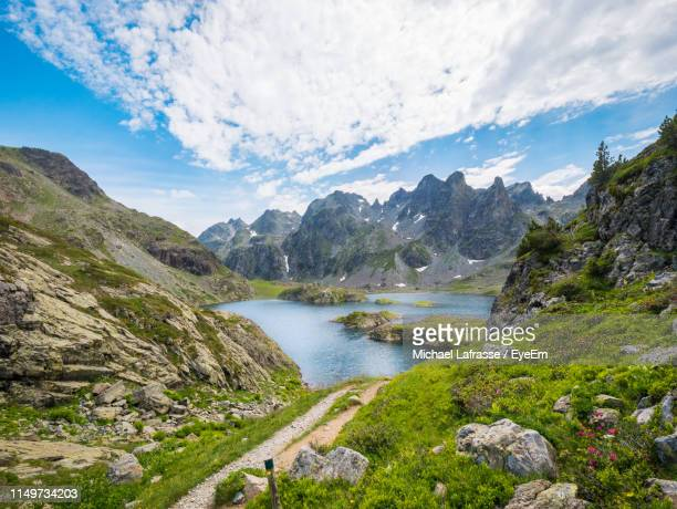scenic view of river amidst mountains against sky - isere stock pictures, royalty-free photos & images