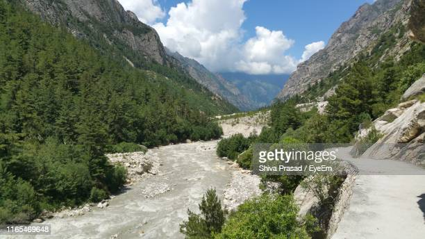 scenic view of river amidst mountains against sky - ganges river stock pictures, royalty-free photos & images