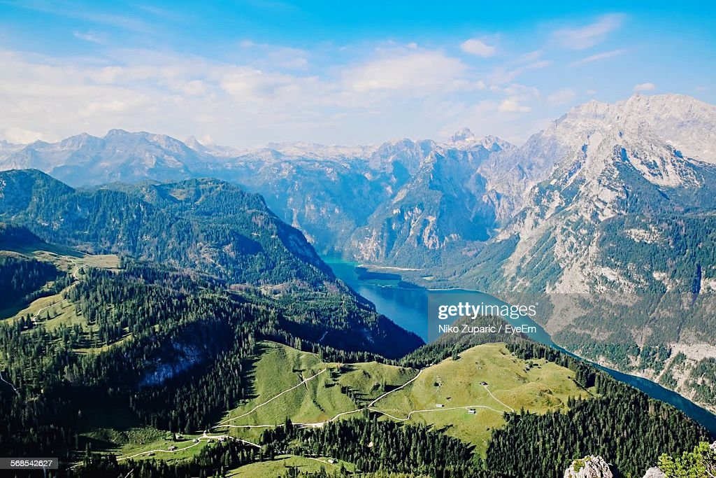 Scenic View Of River Amidst Mountains Against Sky : Stock Photo