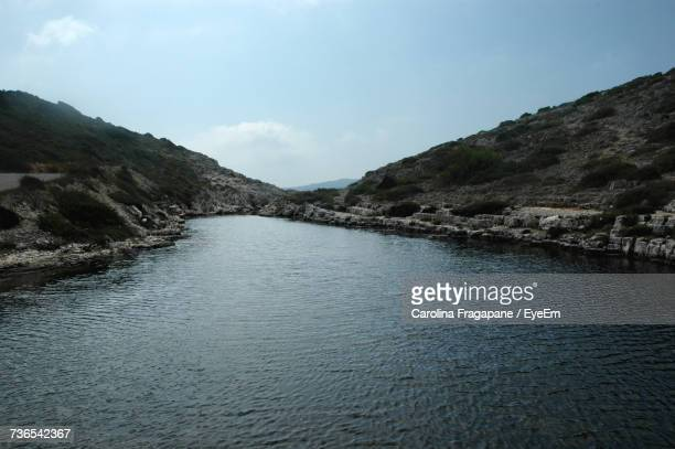 scenic view of river amidst mountains against sky - carolina fragapane stock pictures, royalty-free photos & images