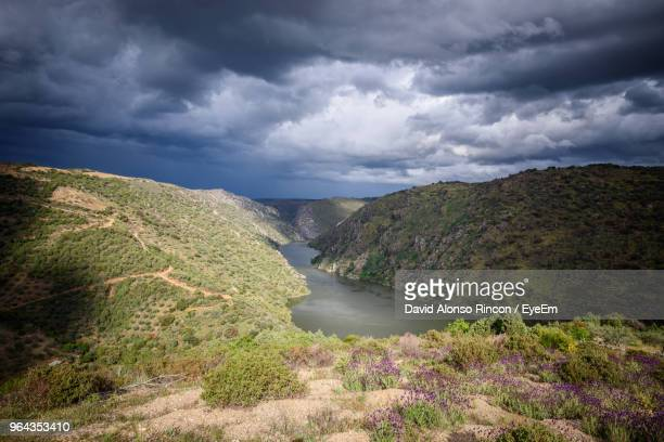 scenic view of river amidst mountains against sky - zamora stock pictures, royalty-free photos & images