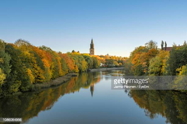 scenic view of river amidst trees against clear sky during autumn - turku finland stock photos and pictures