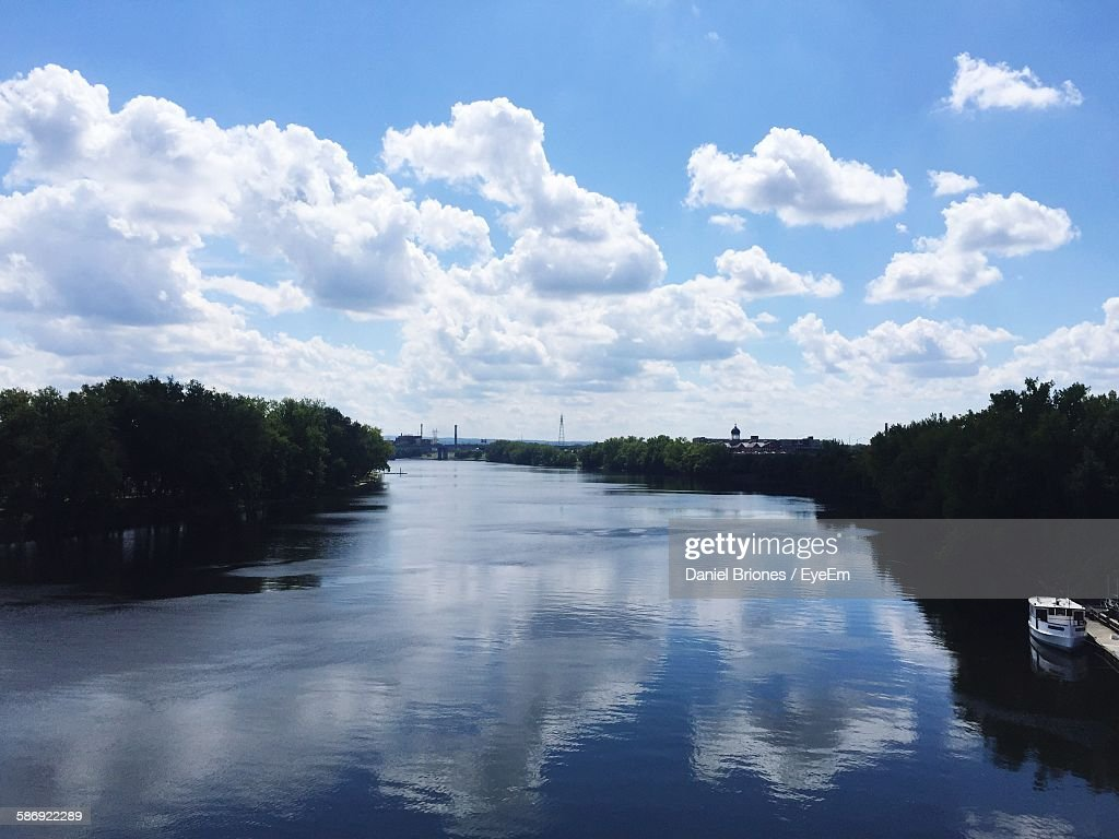 Scenic View Of River Amidst Trees Against Cloudy Sky : ストックフォト