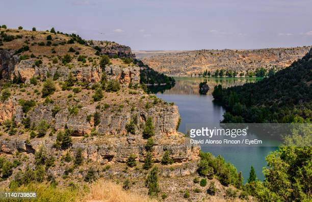 scenic view of river amidst trees against sky - segovia stock pictures, royalty-free photos & images