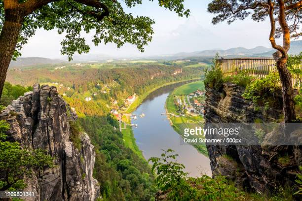 scenic view of river amidst trees against sky, stadt wehlen, germany - stadt stock pictures, royalty-free photos & images