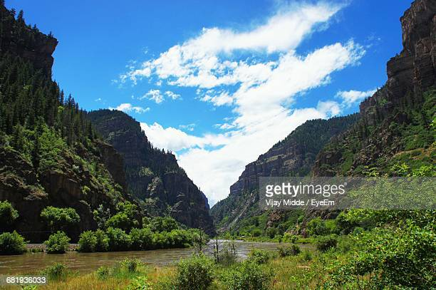 Scenic View Of River Amidst Valley Against Sky