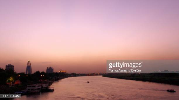 scenic view of river and city against sky during sunset - sudan stock pictures, royalty-free photos & images