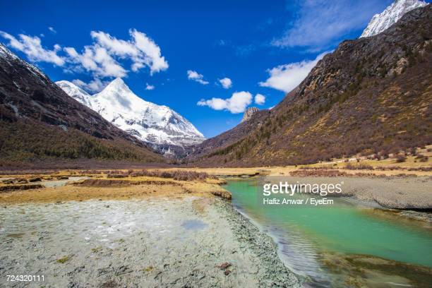 Scenic View Of River And Mountains Against Blue Sky