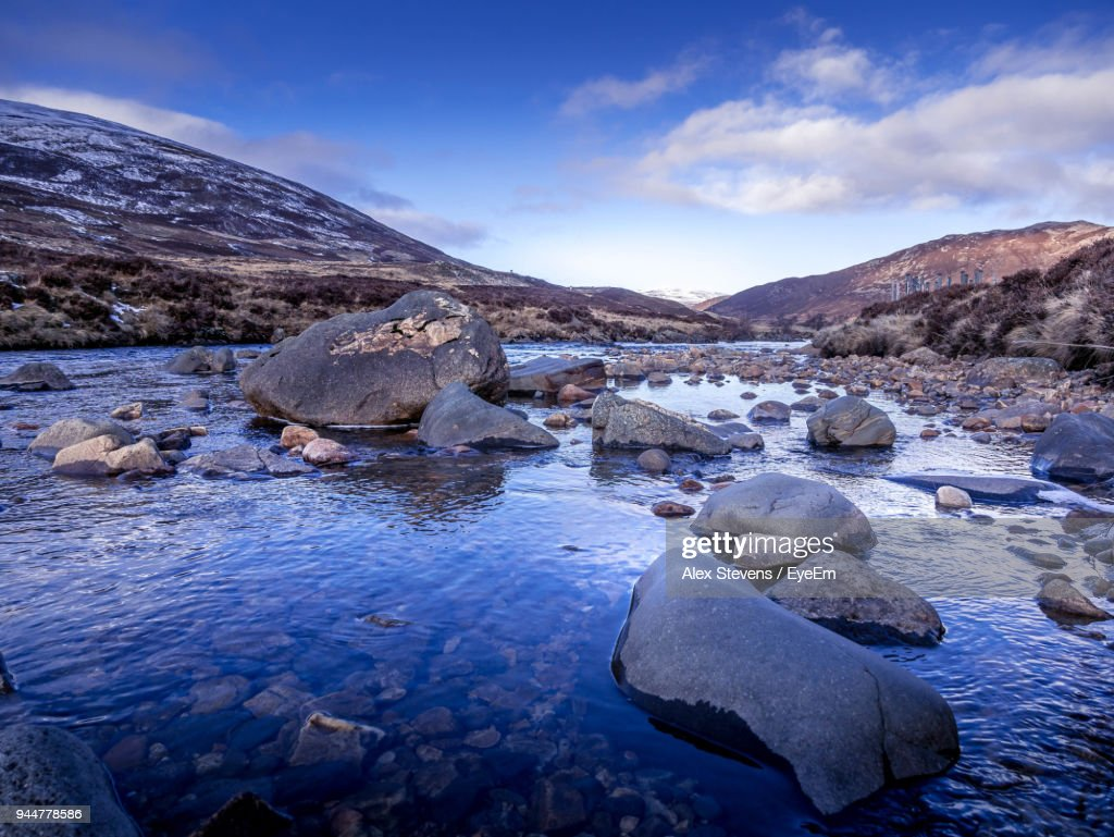 Scenic View Of River And Mountains Against Blue Sky : Stock Photo