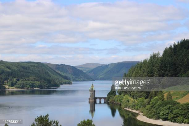 scenic view of river and mountains against sky - lake vyrnwy stock pictures, royalty-free photos & images