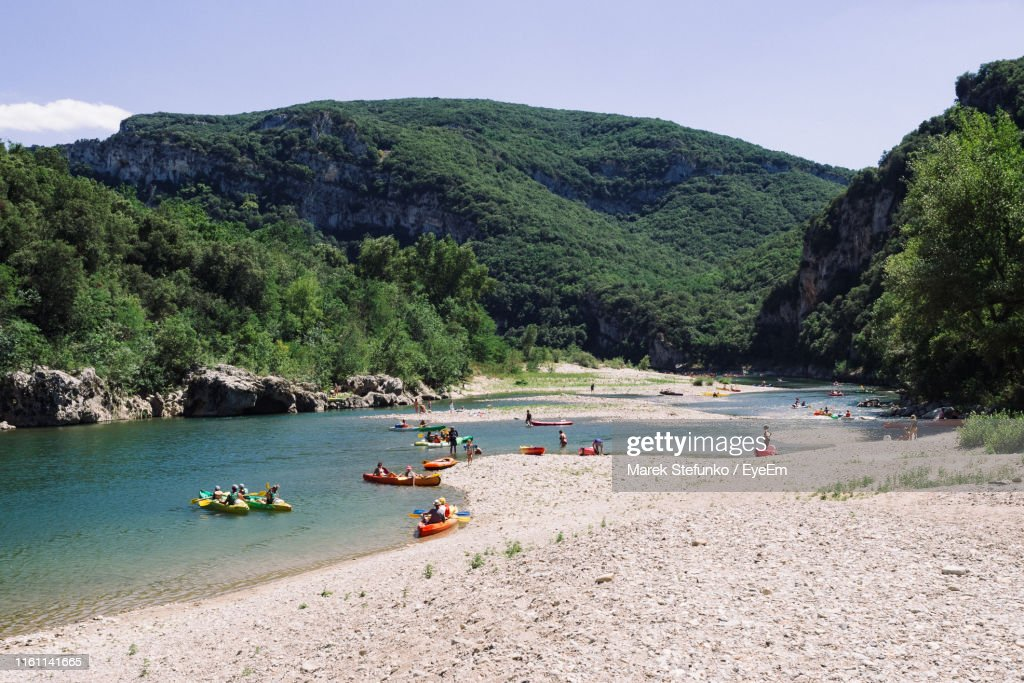 Scenic View Of River And Mountains Against Sky : Stock Photo