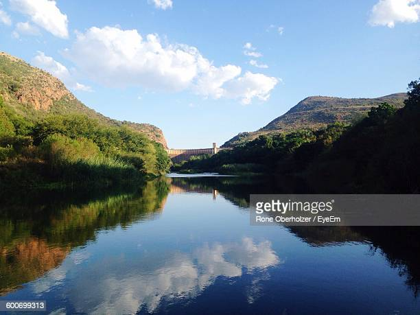 Scenic View Of River And Mountains Against Sky
