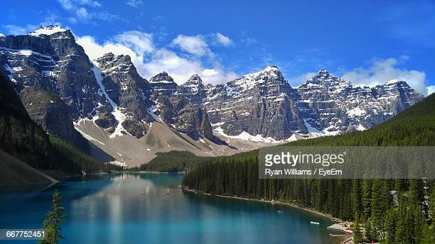 scenic view of river and mountains against sky - banff stock photos and pictures