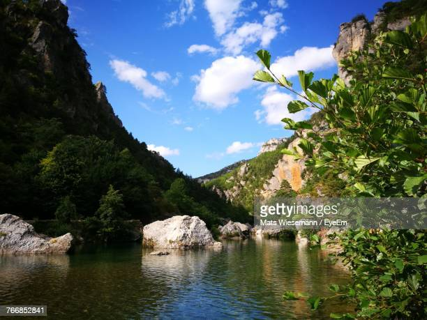 scenic view of river and mountains against sky - aveyron stock pictures, royalty-free photos & images