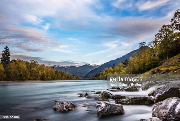 scenic view of river and mountains against sky - bad ragaz stock pictures, royalty-free photos & images