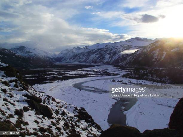 Scenic View Of River And Snowcapped Mountains Against Sky