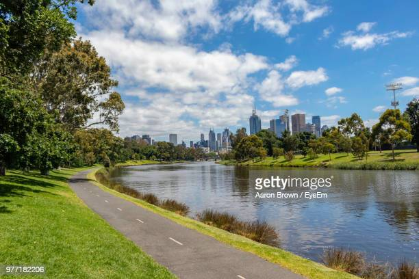 scenic view of river by buildings against sky - victoria stock-fotos und bilder