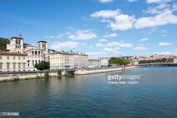 scenic view of river by city against sky - lyon photos et images de collection