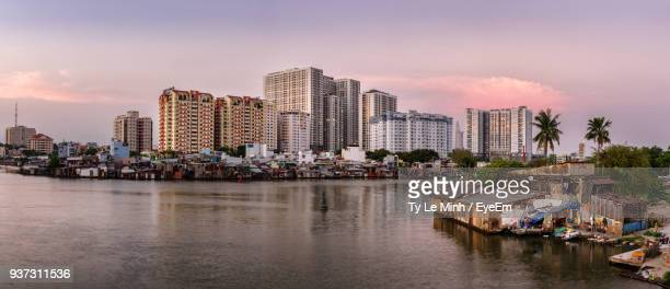scenic view of river by city against sky - slum stock pictures, royalty-free photos & images