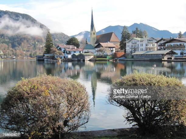 scenic view of river by houses against sky - gerhard schimpf stock pictures, royalty-free photos & images