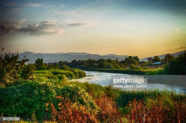 scenic view of river by landscape against sky during sunset - trabzon stock photos and pictures