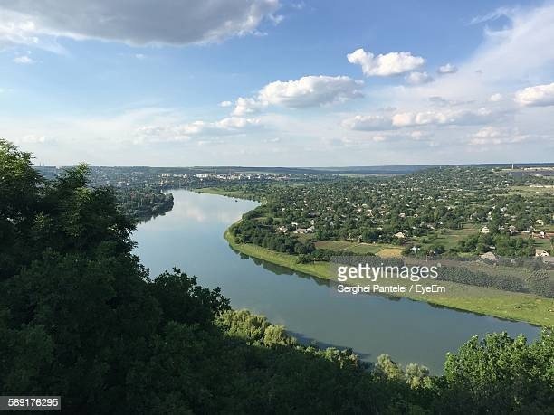scenic view of river by landscape against sky - chisinau stock pictures, royalty-free photos & images