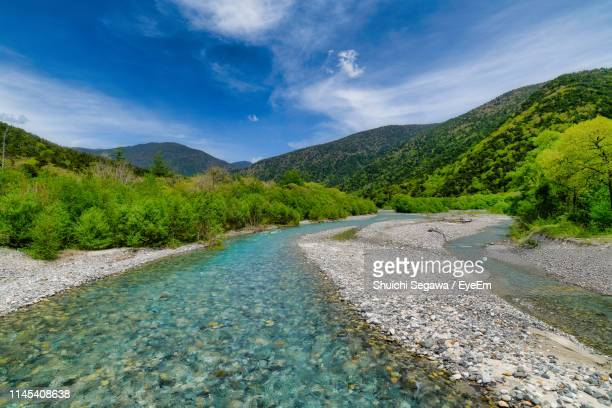 scenic view of river by mountains against sky - 中部地方 ストックフォトと画像