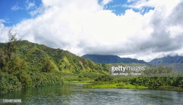 scenic view of river by mountains against sky - krings stock pictures, royalty-free photos & images
