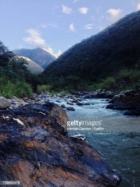 scenic view of river by mountains against sky - hannah brooks stock pictures, royalty-free photos & images