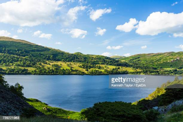 scenic view of river by mountains against sky - ambleside stock photos and pictures