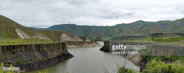Scenic View Of River By Mountains Against Sky
