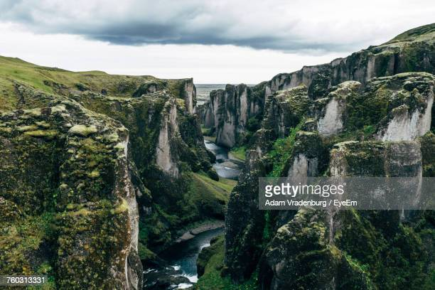 scenic view of river by mountains against sky - selfoss stock photos and pictures