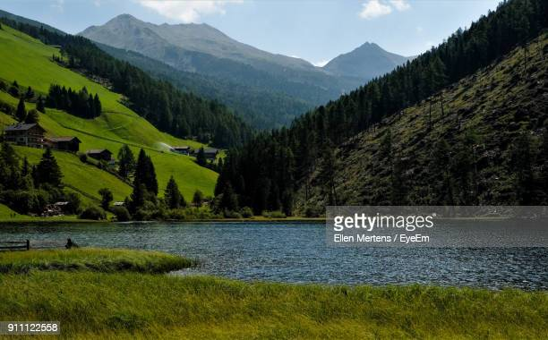 scenic view of river by mountains against sky - mertens stock pictures, royalty-free photos & images