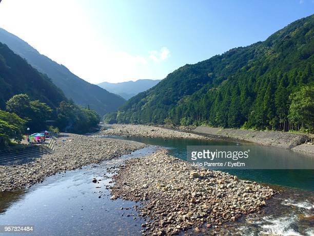 scenic view of river by mountains against sky - mie prefecture stock pictures, royalty-free photos & images
