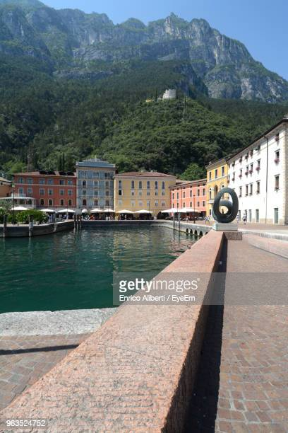 scenic view of river by mountains against sky - enrico aliberti stock-fotos und bilder