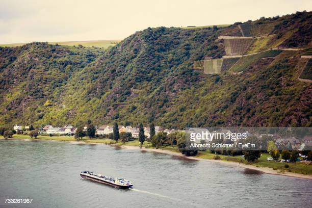 scenic view of river by trees against sky - albrecht schlotter stock photos and pictures