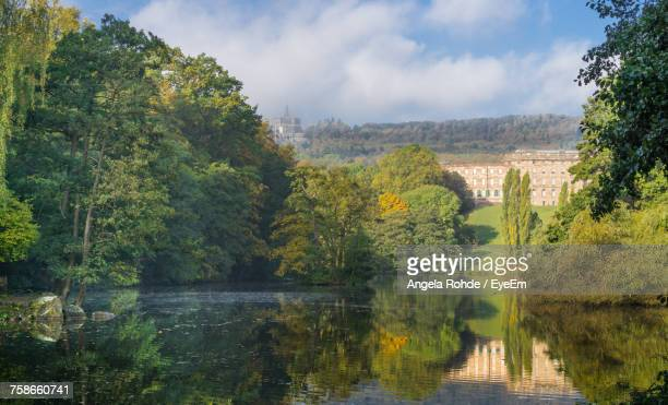 scenic view of river by trees against sky - angela rohde stock-fotos und bilder