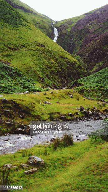 scenic view of river flowing against mountains - dumfries and galloway stock pictures, royalty-free photos & images