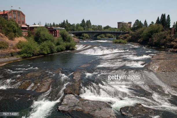 scenic view of river flowing against sky - spokane stock pictures, royalty-free photos & images