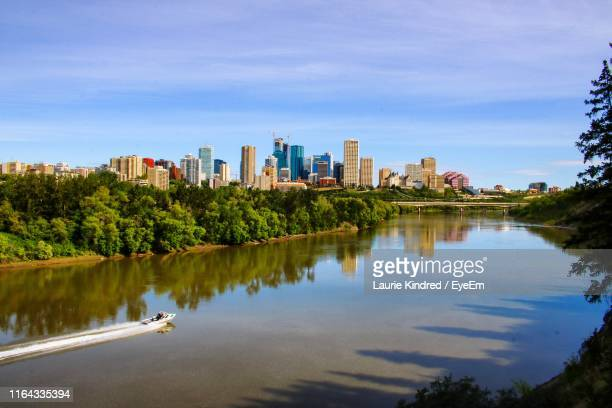 scenic view of river in city against sky - edmonton stock pictures, royalty-free photos & images