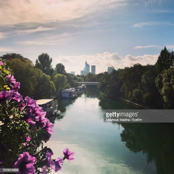 Scenic View Of River In City Against Sky