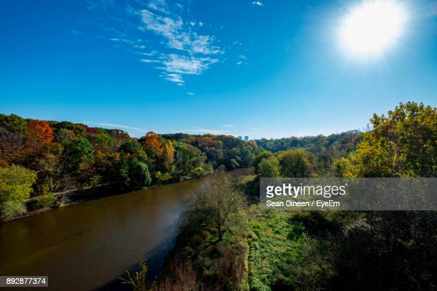 scenic view of river in forest against sky - milwaukee wisconsin stock photos and pictures