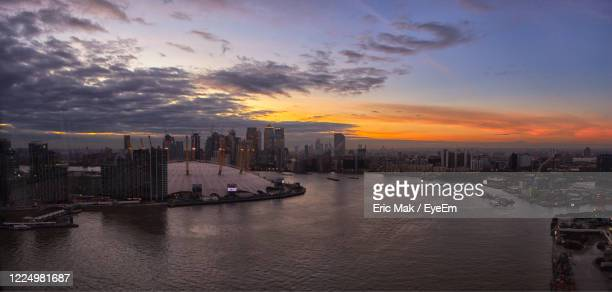 scenic view of river thames and o2 arena against sky during sunset - the o2 england stock pictures, royalty-free photos & images