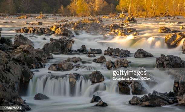 scenic view of river with waterfalls - potomac maryland stock pictures, royalty-free photos & images