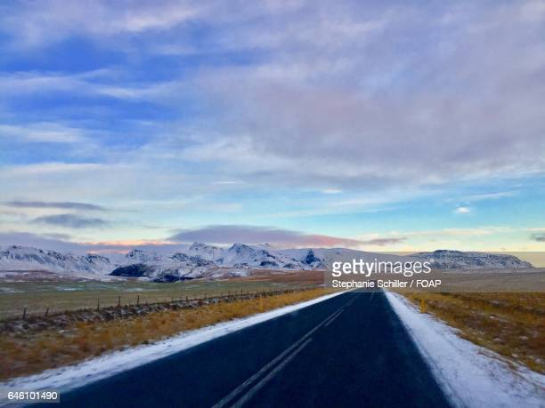 Scenic view of road against cloudy sky